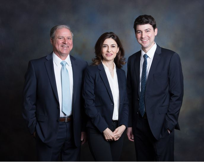 Dr. Mark Waller, Dr. Hala Badawi, and Dr. Dan Waller from Sussex Dental