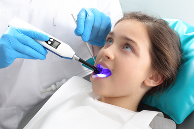 Young patient receiving dental sealants procedure at Sussex Dental